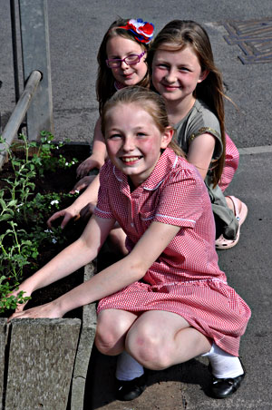 The girls help outside New Buildings